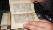 مصحف قديم مزين بالذهب الخالص